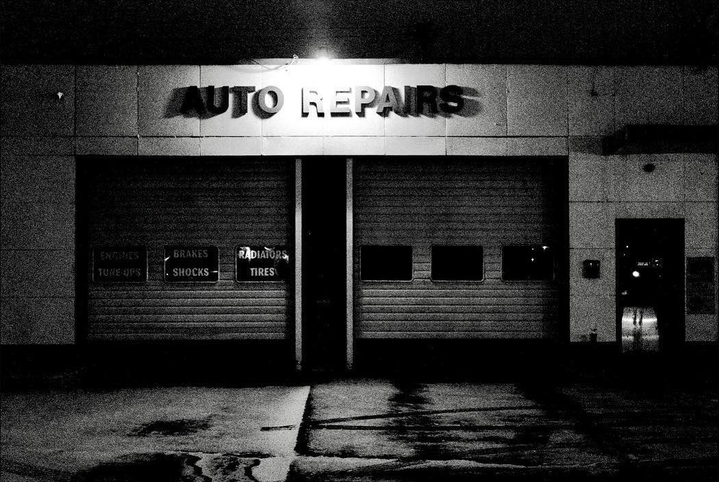Auto repair shop shot at night with a Ricoh GR2 by Jay Sennett