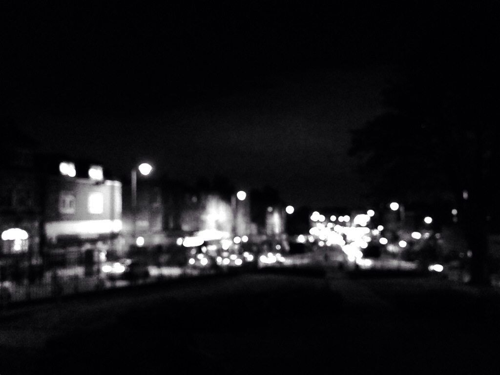 A black and white photo of a city that is blurred.