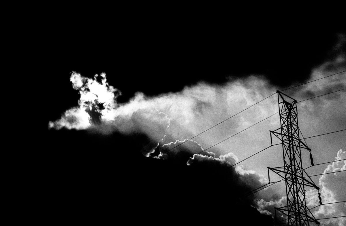 Storm clouds open up in front of a power line. Shot with a Canon 60D by Jay Sennett