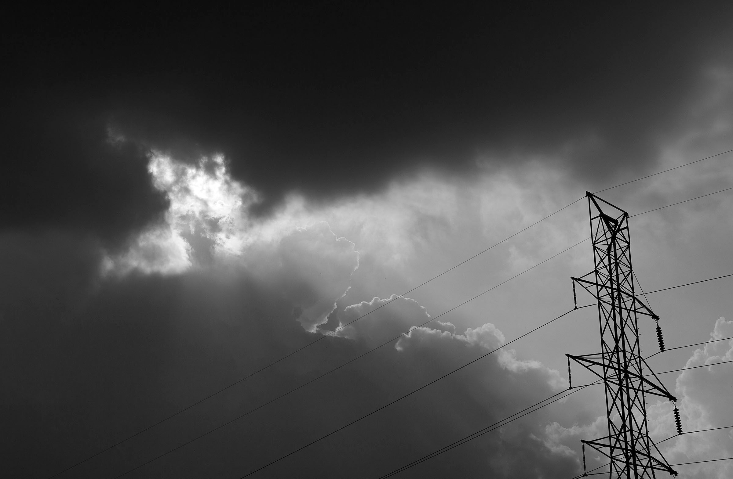 clouds with power tower